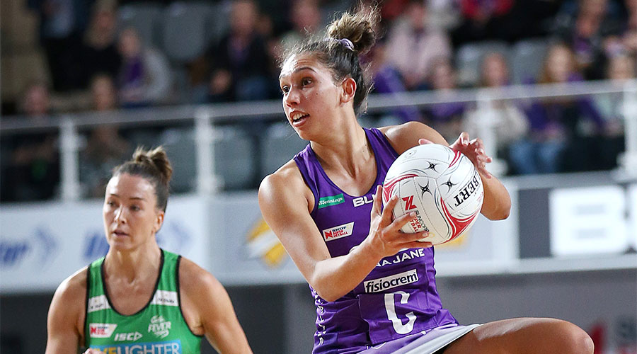 Jemmi MiMi from Firebirds with the ball