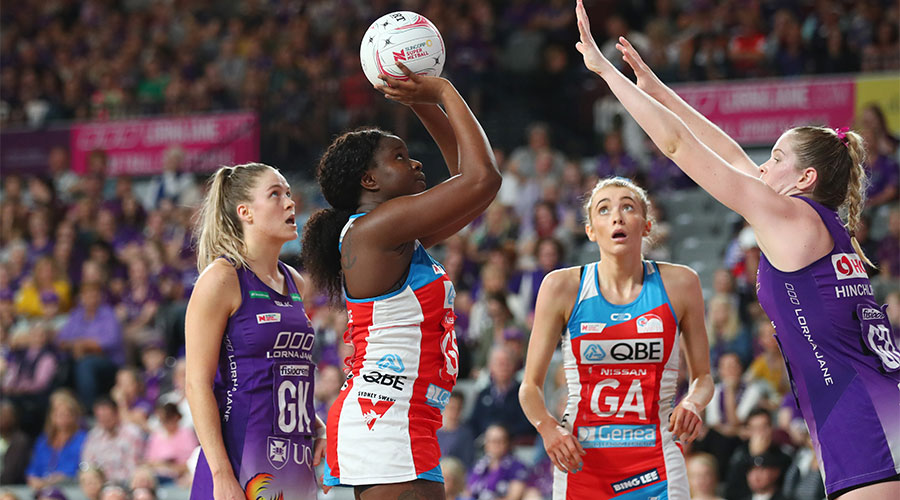 Swifts Sam Wallace shooting for goal with Firebirds Tara Hinchliffe defending