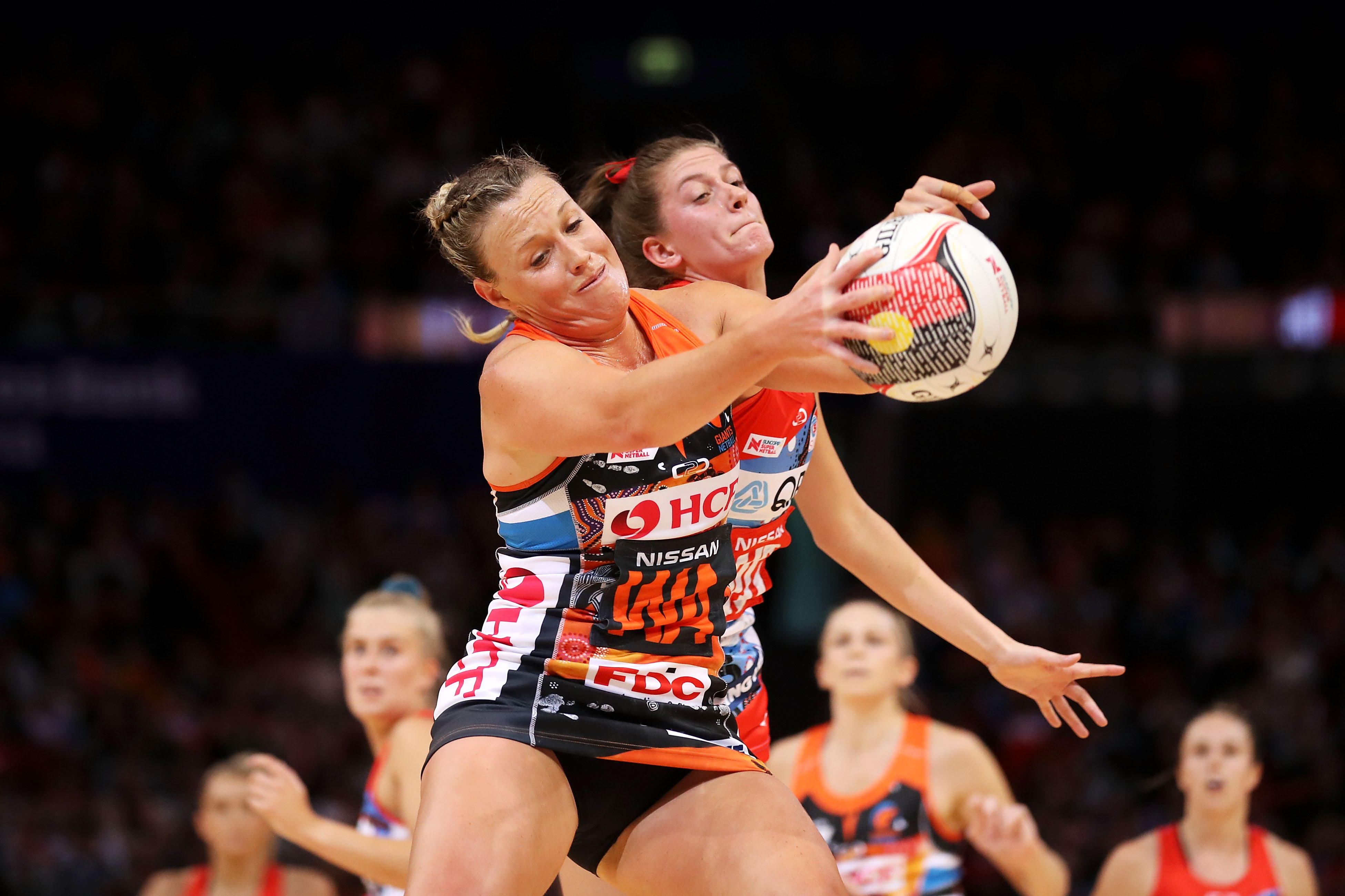 Giants Kim Green Contesting the Ball against Swifts Kate Eddy