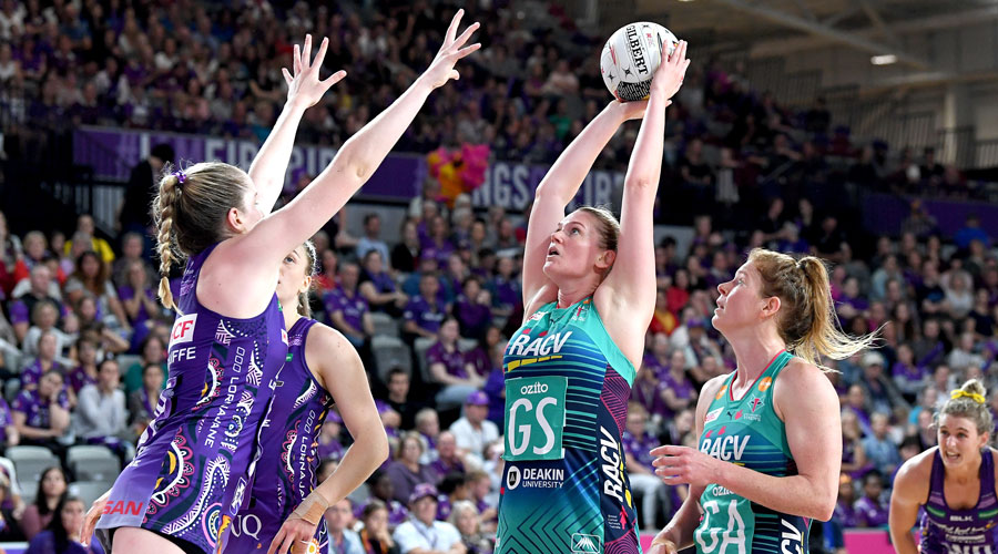 Vixens' Caitlin Thwaites lines up a shot whilst Firebirds Tara Hinchcliffe defends