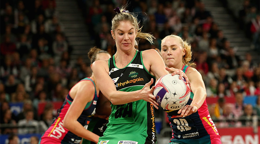 Kaylia Stanton reaching for the ball against Vixens defenders
