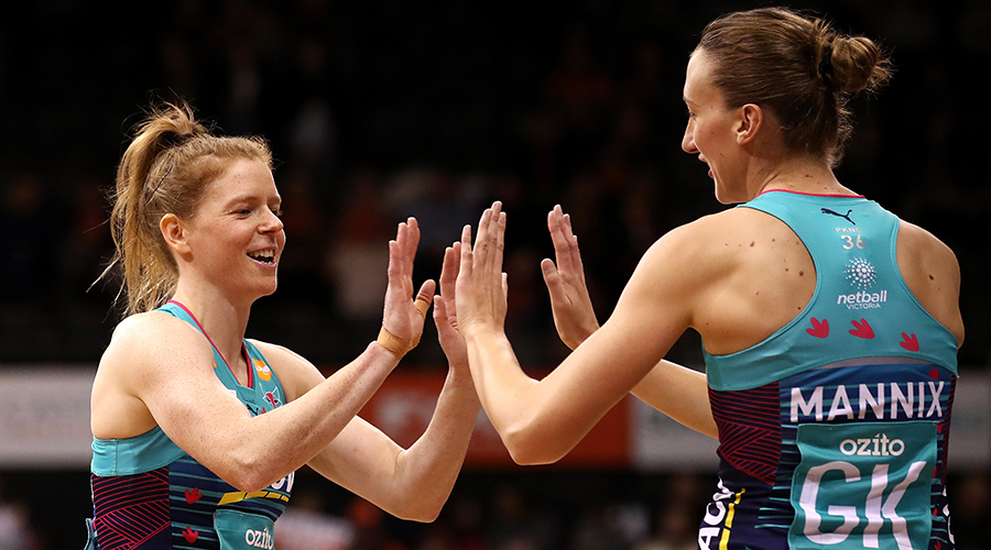 Emily Mannix welcomes Melbourne Vixens teammate Tegan Philip on to the court before their match against GIANTS Netball in Round 9