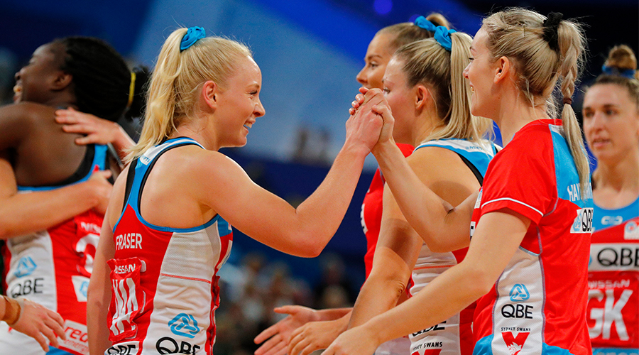 Tayla Fraser of the NSW Swifts high fives her team mates during the round 10 Super Netball match between the Fever and the Swifts at RAC Arena on July 27, 2019 in Perth, Australia.