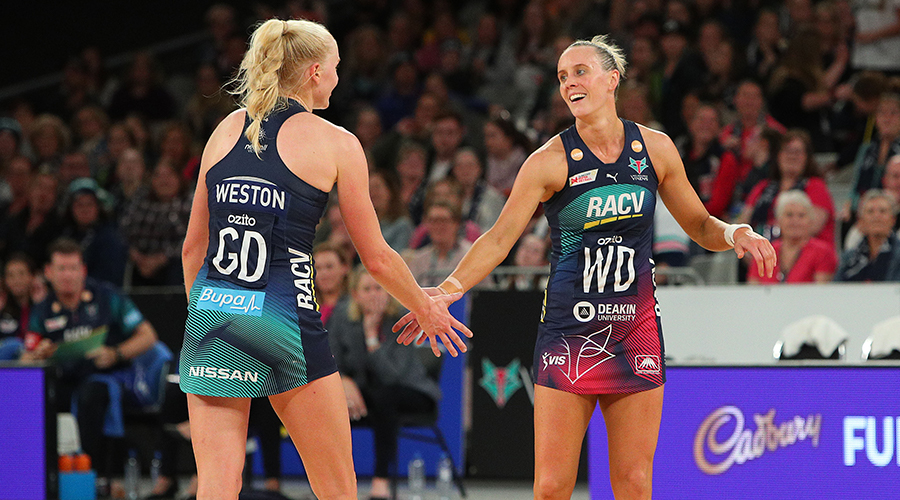 Renae Ingles of the Vixens (R) and Jo Weston of the Vixens celebrate victory in the round two Super Netball match between the Melbourne Vixens and the Giants at Melbourne Arena on May 05, 2019 in Melbourne, Australia.