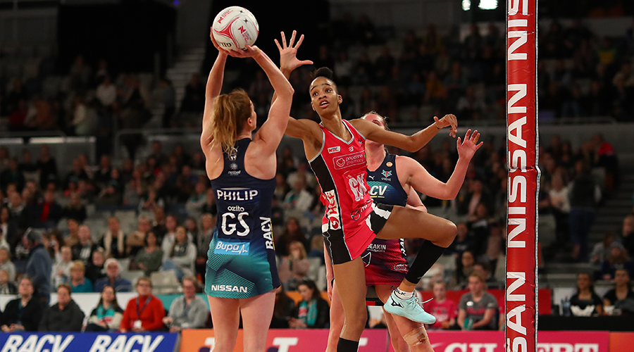 Tegan Philip of the Vixens (L) shoots under pressure from Shamera Sterling of the Thunderbirds during the round 10 Super Netball match between the Vixens and the Thunderbirds at Melbourne Arena on July 28, 2019 in Melbourne, Australia.