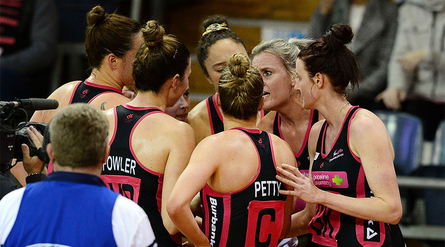 Adelaide Thunderbirds in a team huddle