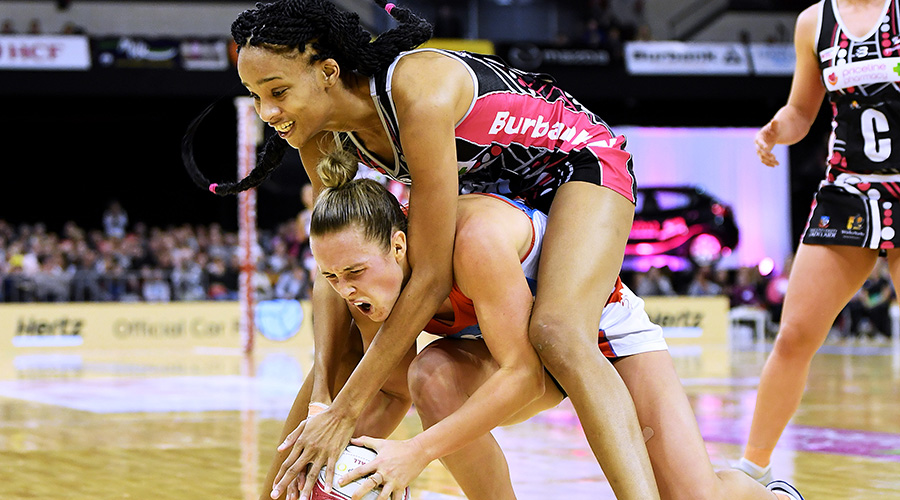 Adelaide Thunderbirds goal keeper Shamera Sterlin clashes with Paige Hadley