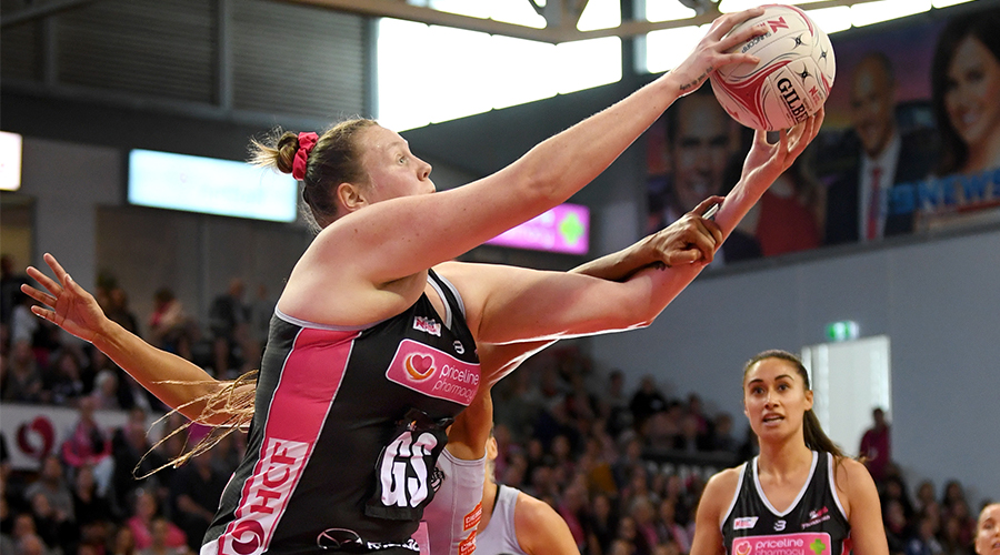 Emma Ryde of the Thunderbirds catches in front of Geva Mentor of the Magpies during the round 11 Super Netball match between the Thunderbirds and Magpies at Priceline Stadium on August 04, 2019 in Adelaide, Australia.
