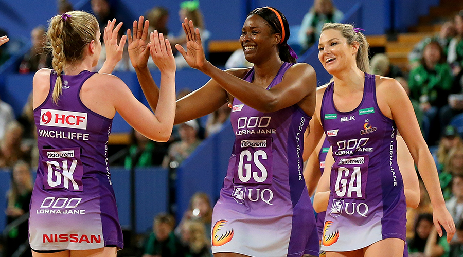 Romelda Aiken of the Queensland Firebirds and Tara Hinchcliffe of the Queensland Firebirds high five as they finish the 3rd quarter during the round 13 Super Netball match between the West Coast Fever and the Queensland Firebirds at RAC Arena on August 18, 2019 in Perth, Australia.