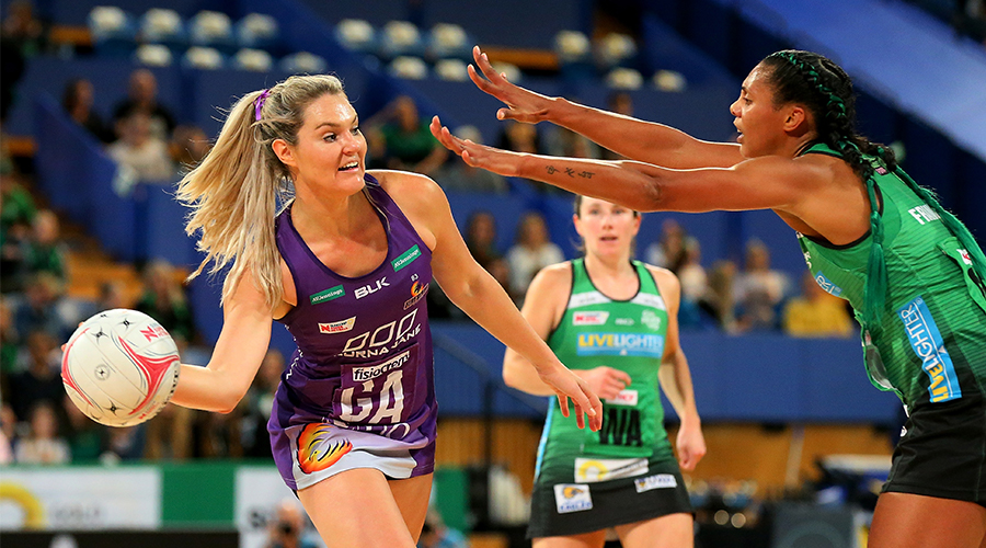 Gretel Tippett of the Queensland Firebirds passes the ball around Stacey Francis of the fever during the round 13 Super Netball match between the West Coast Fever and the Queensland Firebirds at RAC Arena on August 18, 2019 in Perth, Australia.