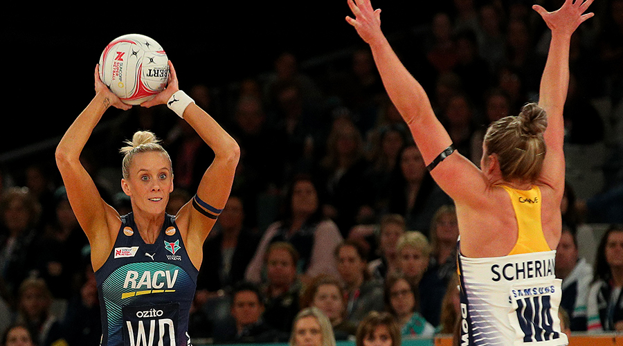 Melbourne Vixens Renae Ingles looks to pass over Sunshine Coast Lightning's Laura Scherian