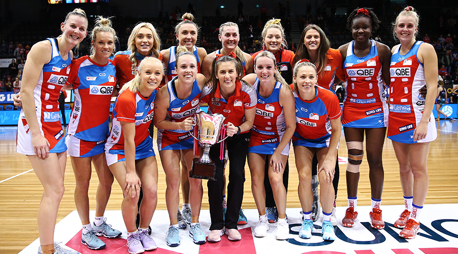 Players from the Sydney Swifts pose with the Sargeant McKinnis Cup during the round 12 Super Netball match between the Sydney Swifts and the Melbourne Vixens at Quay Centre on August 10, 2019 in Sydney, Australia.