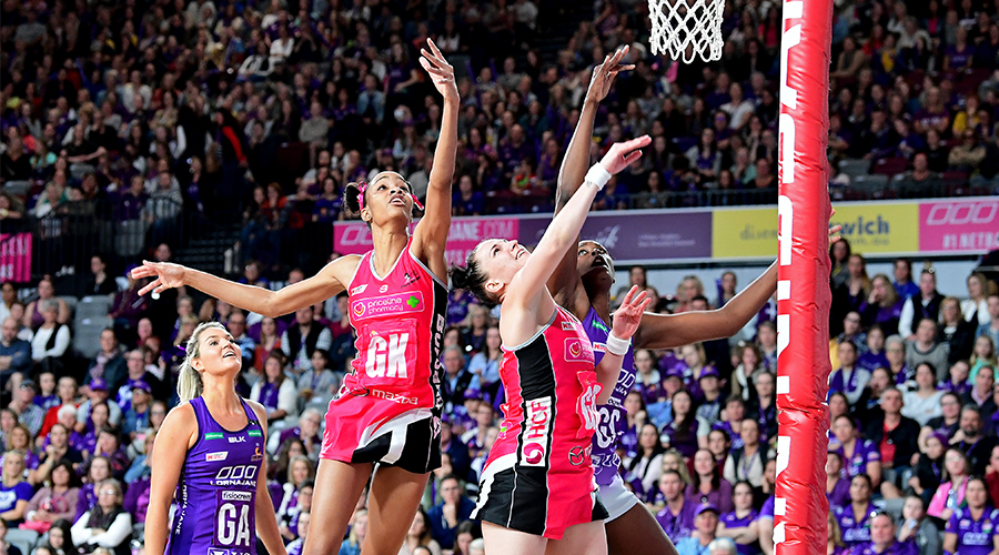 Romelda Aiken of the Firebirds is challenged by the defence of Shamera Sterling and Kate Shimmin of the Thunderbirds during the round 12 Super Netball match between the Queensland Firebirds and Adelaide Thunderbirds at Brisbane Arena on August 11, 2019 in Brisbane, Australia.