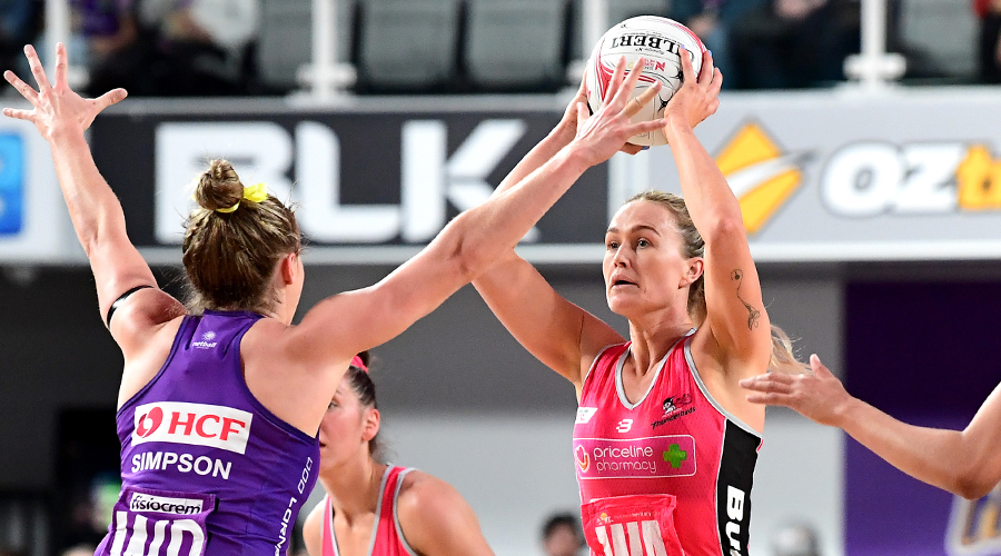 Adelaide Thunderbirds Chelsea Pitman looks to pass over Firebirds Gabi Simpson
