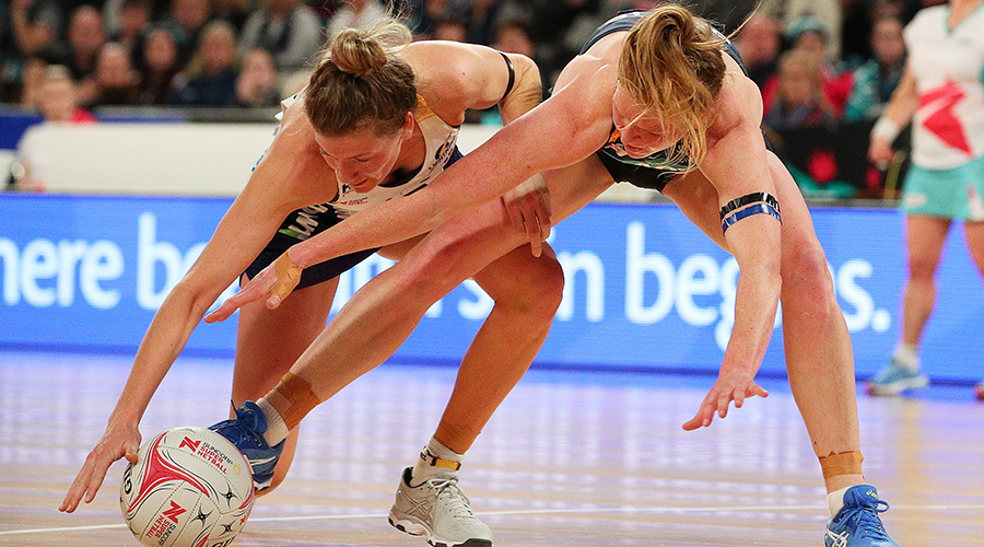 Tegan Philip of the Vixens (R) and Karla Pretorius of the Lightning compete for the ball during the round 13 Super Netball match between the Melbourne Vixens and the Sunshine Coast Lightning at Melbourne Arena on August 18, 2019 in Melbourne, Australia.