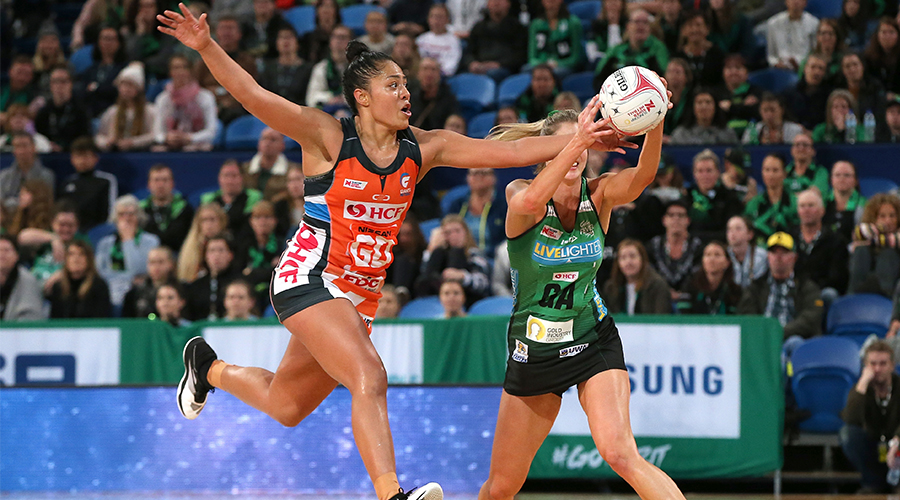 Kristiana Manu'a of the Giants attempts to intercept the ball against Kaylia Stanton of the Fever during the round 7 Super Netball match between the Fever and the Giants at RAC Arena on June 08, 2019 in Perth, Australia.