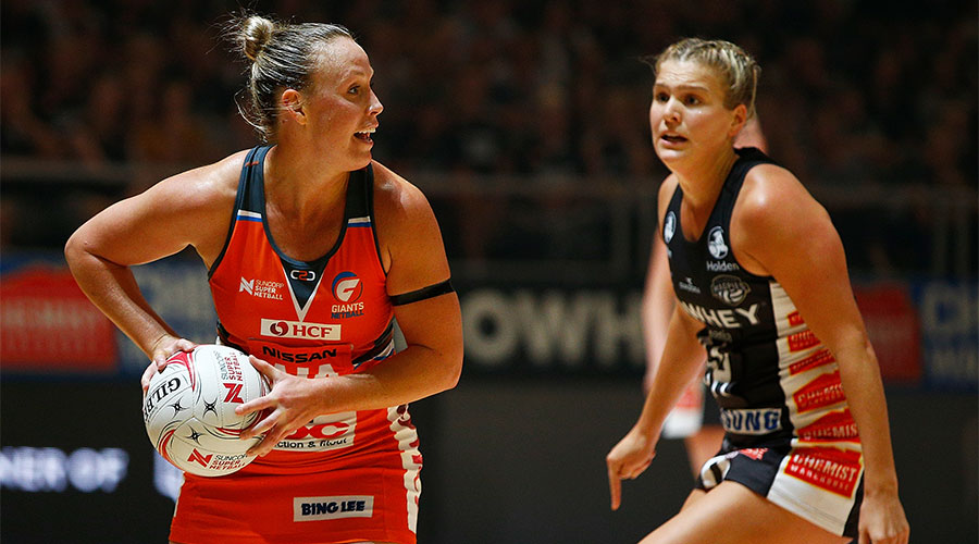Kim Green looking to pass the ball whilst being defended by Shae Brown