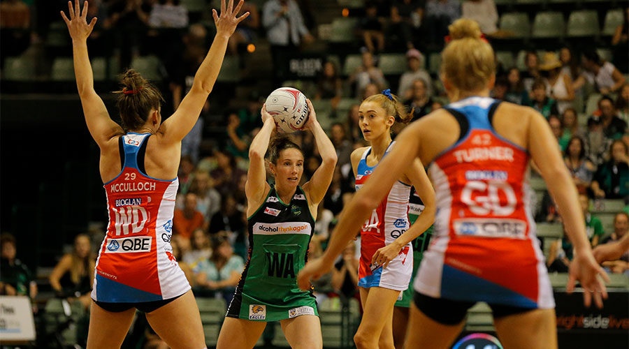 Ingrid Coyler passing the ball against Swifts defenders