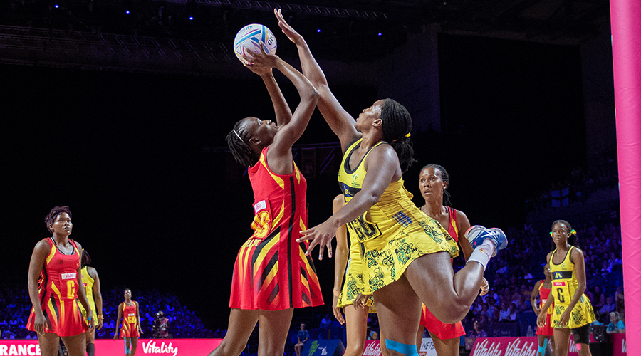Jodiann Ward (R) of Jamaica attempts to block a shot from Stella Oyella (L) of Uganda during their Vitality Netball World Cup match at M&S Bank Arena on July 18, 2019 in Liverpool, England.