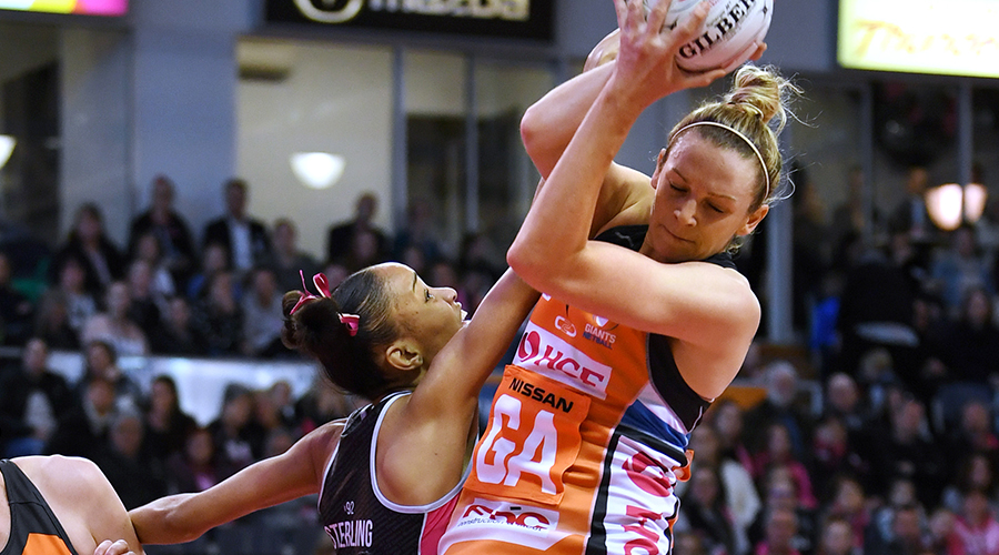 Joanne Harten of the Giants catches the ball over Shamera Sterling of the Thunderbirds during the round 13 Super Netball match between the Adelaide Thunderbirds and the Greater Western Sydney Giants at Adelaide Entertainment Centre on August 18, 2019 in Adelaide, Australia.