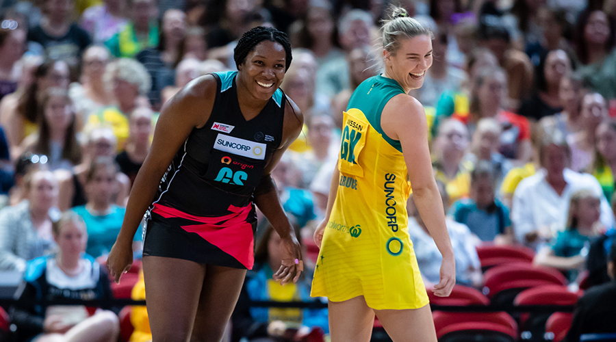West Coast Fever teammates Jhaniele Fowler and Courtney Bruce share a laugh during the Bushfrie Relief Match at Sydney's Qudos Bank Arena.
