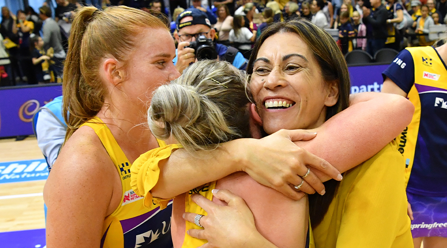 Lightning coach Noeline Taurua (centre) embraces Laura Scherian of the Lightning following their win of the Super Netball semi-final match between the Sunshine Coast Lightning and the NSW Swifts at the USC Stadium on the Sunshine Coast, Saturday, August 31, 2019.