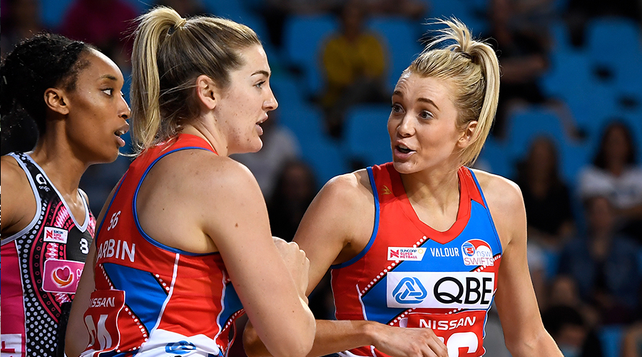 Sophie Garbin and Helen Housby of the Swifts celebrate a super shot during the Round 13 Super Netball match between the Adelaide Thunderbirds and NSW Swifts at Pop Up Arena in Cairns Saturday, September 19, 2020.