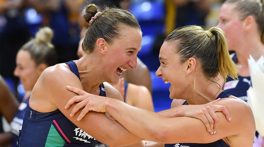 Emily Mannix (centre) and Liz Watson (right) of the Vixens celebrates winning the Major Semi-Final Super Netball match between the Melbourne Vixens and the Sunshine Coast Lightning at USC Stadium on the Sunshine Coast, Saturday, October 3, 2020.