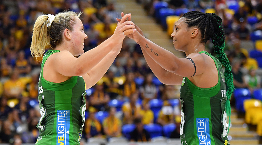 Jess Anstiss (left) and Stacey Francis (right) of the Fever celebrate during the Super Netball Preliminary Final match between the Sunshine Coast Lightning and West Coast Fever at USC Stadium on the Sunshine Coast, Sunday, October 11, 2020.