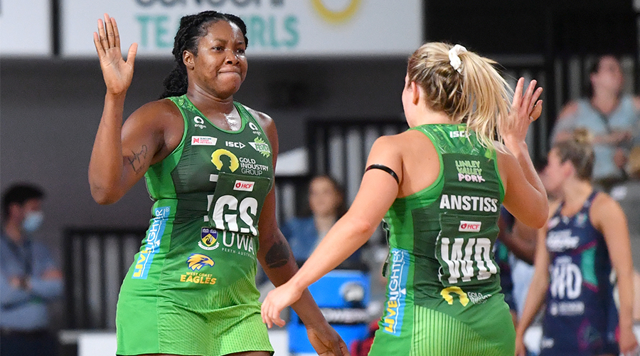 Jhaniele Fowler (left) of the Fever celebrates shooting a goal with team mate Jess Anstiss (right) during the Super Netball Grand Final between the Melbourne Vixens and West Coast Fever at Nissan Arena in Brisbane, Sunday, October 18, 2020.